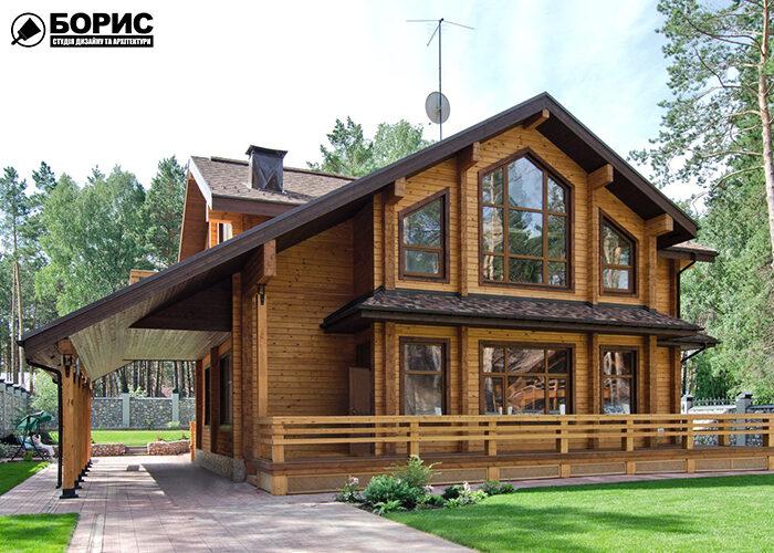 Двоповерховий з дерев'яного бруса з великими вікнами.