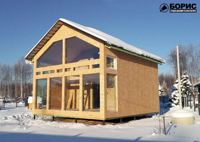 Процес будівництва каркасного будинку листового типу в Харкові.