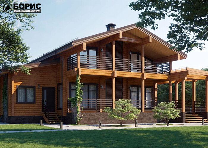 Деревянный двухэтажный большой дом с балконом и гаражем